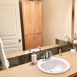 Full Bathroom upstairs with many amenities and shelves