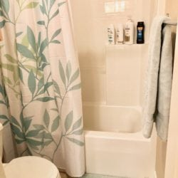 Shower upstairs, separated by sliding door to sink and vanity.