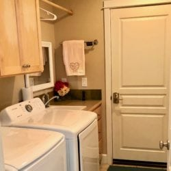 Laundry Room with new washer + dryer, leads to the garage.